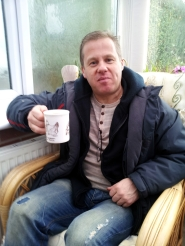Pat enjoying a brew and biscuit